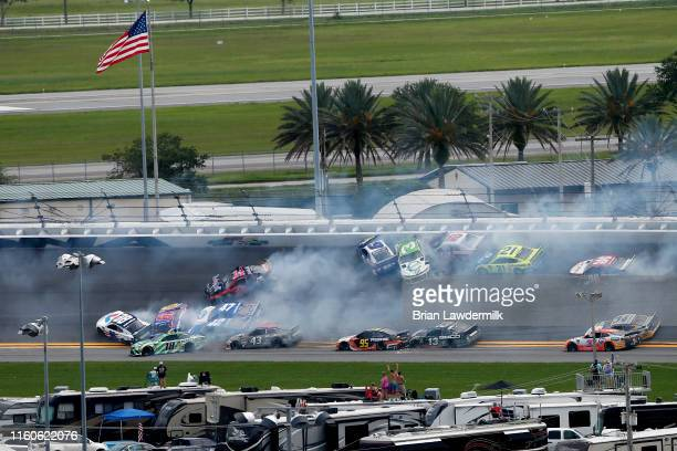 Austin Dillon driver of the American Ethanol Chevrolet and Clint Bowyer driver of the Mobil 1/Rush Truck Centers Ford start an ontrack incident...