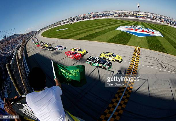 Austin Dillon driver of the American Ethanol Chevrolet and Joey Logano driver of the Dollar General Toyota lead the field at the start of during the...