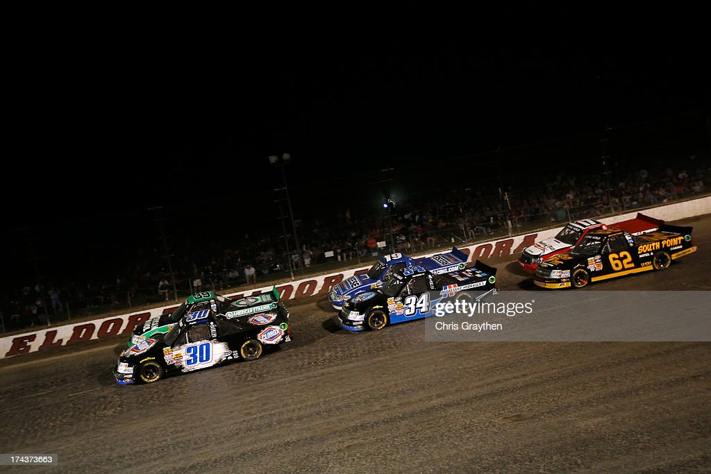 Austin Dillon, driver of the #39 American Ethanol Chevrolet, and Kyle Larson, driver of the #30 Clorox Chevrolet, lead the field during the NASCAR Camping World Truck Series inaugural CarCash Mudsummer Classic at Eldora Speedway on July 24, 2013 in Rossburg, Ohio.