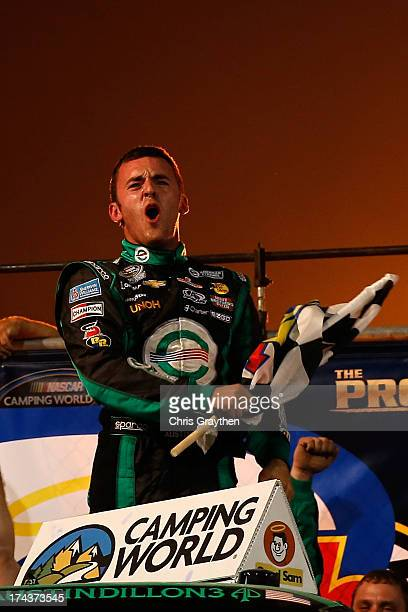 Austin Dillon, driver of the American Ethanol Chevrolet, celebrates after winning the NASCAR Camping World Truck Series inaugural CarCash Mudsummer...
