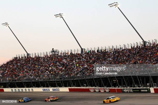 Austin Dillon driver of the American Ethanol Chevrolet leads a pack of cars during the Monster Energy NASCAR Cup Series Bojangles' Southern 500 at...