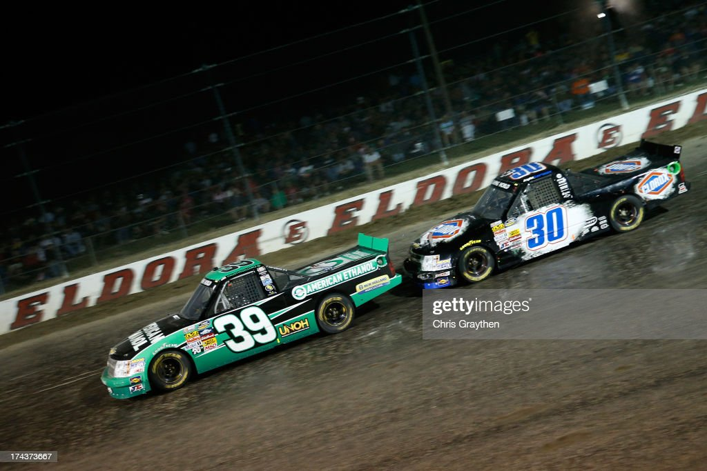Austin Dillon, driver of the #39 American Ethanol Chevrolet, leads Kyle Larson, driver of the #30 Clorox Chevrolet, during the NASCAR Camping World Truck Series inaugural CarCash Mudsummer Classic at Eldora Speedway on July 24, 2013 in Rossburg, Ohio.
