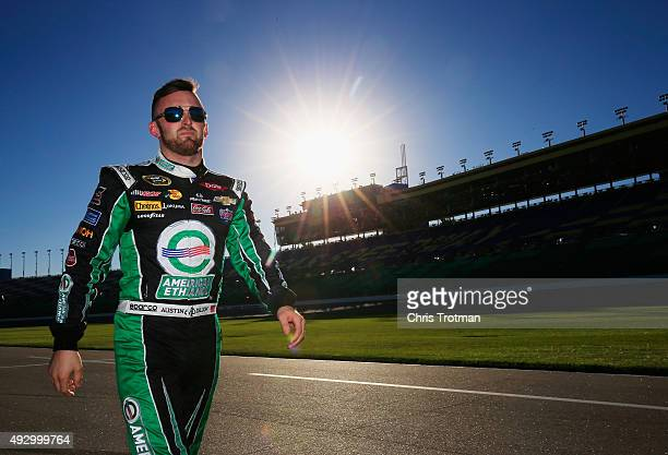 Austin Dillon, driver of the American Ethanol Chevrolet, walks down pit road prior to qualifying for the NASCAR Sprint Cup Series Hollywood Casino...