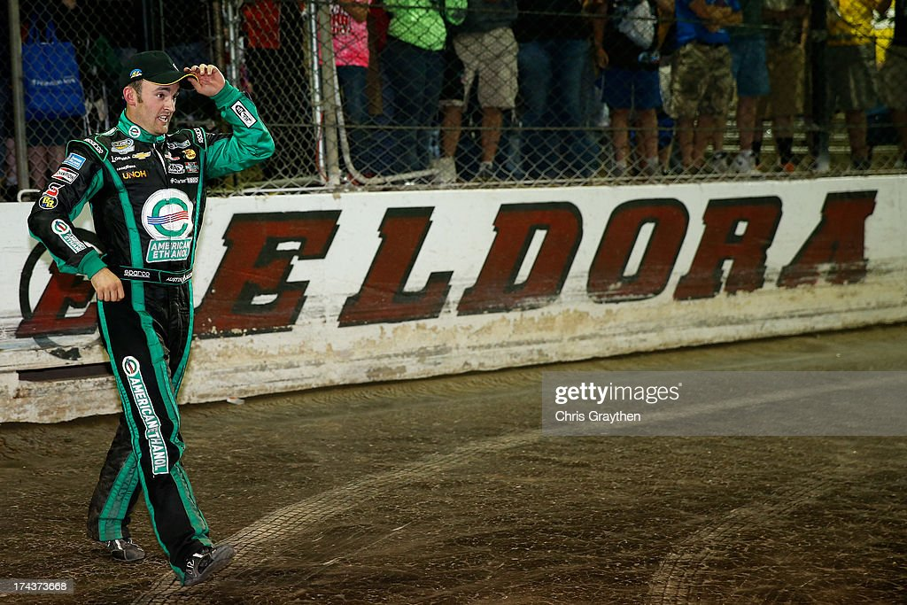 Austin Dillon, driver of the #39 American Ethanol Chevrolet, walks on the track after winning the NASCAR Camping World Truck Series inaugural CarCash Mudsummer Classic at Eldora Speedway on July 24, 2013 in Rossburg, Ohio.