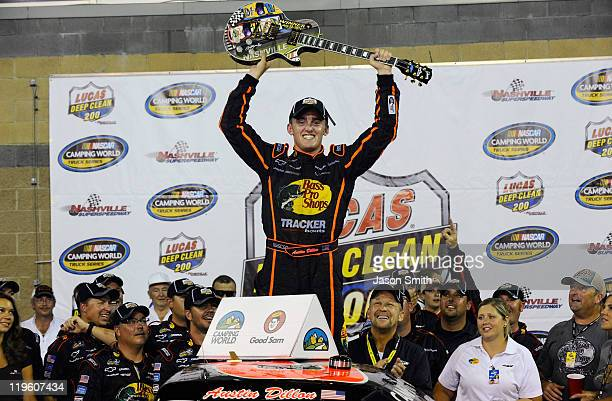 Austin Dillon, driver of the Bass Pro Shops Chevrolet, celebrates in victory lane after winning the NASCAR Camping World Truck Series Lucas Deep...