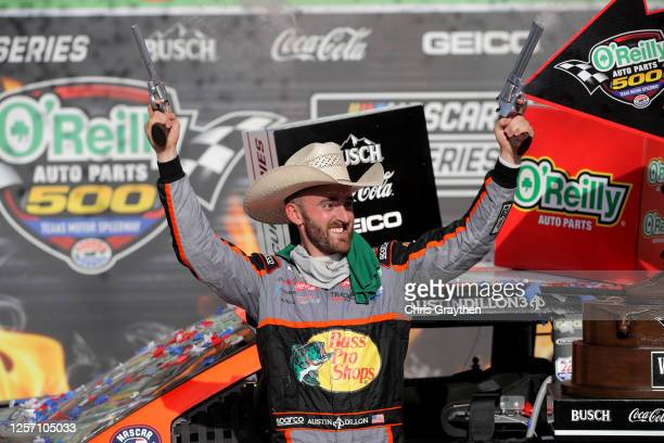 Austin Dillon, driver of the Bass Pro Shops Chevrolet, celebrates in Victory Lane after winning the NASCAR Cup Series O'Reilly Auto Parts 500 at...