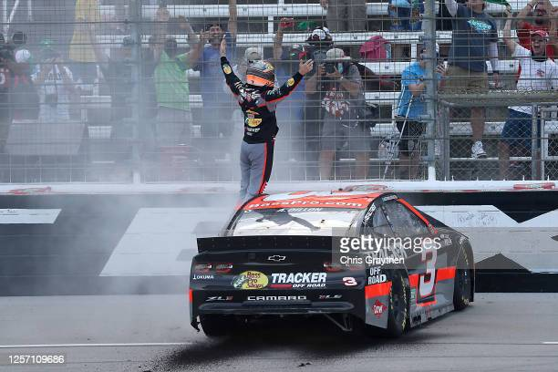 Austin Dillon, driver of the Bass Pro Shops Chevrolet, celebrates winning the NASCAR Cup Series O'Reilly Auto Parts 500 at Texas Motor Speedway on...
