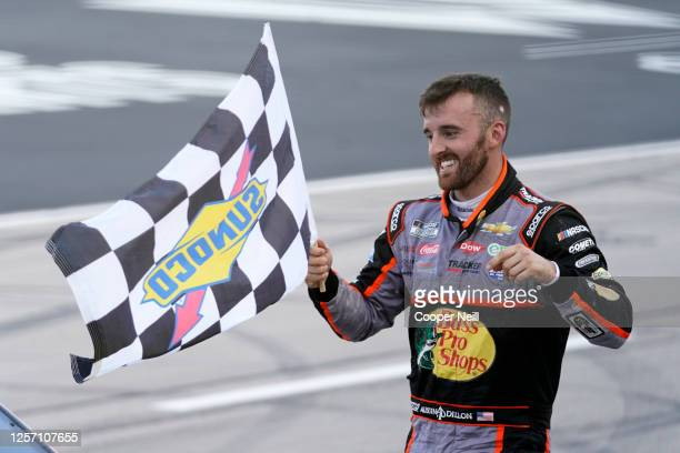 Austin Dillon, driver of the Bass Pro Shops Chevrolet, celebrates with the checkered flag after winning the NASCAR Cup Series O'Reilly Auto Parts 500...