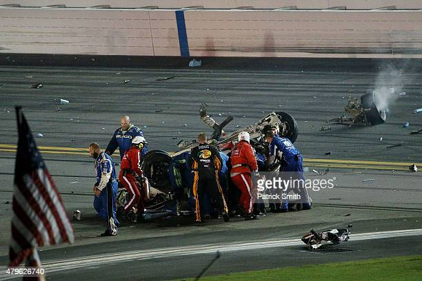 Austin Dillon, driver of the Bass Pro Shops Chevrolet, receives medical attention after a crash following the checkered flag during the NASCAR Sprint...