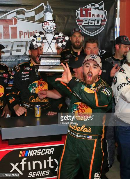 Austin Dillon driver of the Bass Pro Shops/Cabela's Chevrolet celebrates with the trophy after winning the NASCAR Xfinity Series LTi Printing 250 at...