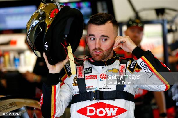 Austin Dillon driver of the Bass Pro Shops/Tracker Boats Chevrolet stands in the garage area during practice for the Monster Energy NASCAR Cup Series...