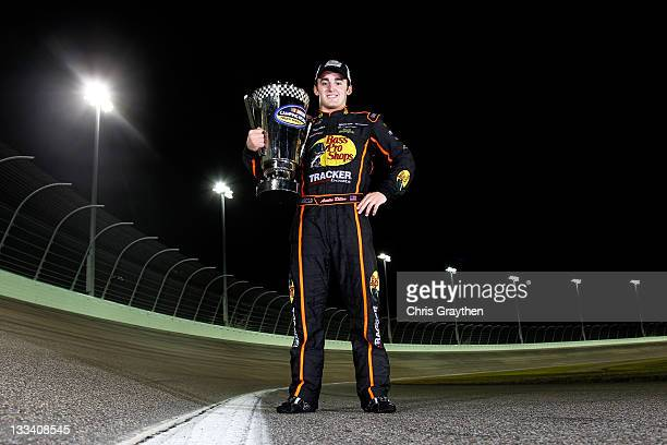 Austin Dillon, driver of the Bass Pro Shops/Tracker Chevrolet, poses with the championship trophy after winning the 2011 Series Championship in the...