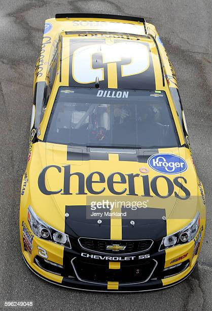 Austin Dillon driver of the Cheerios Chevrolet drives through the garage area during practice for the NASCAR Sprint Cup Series Pure Michigan 400 at...