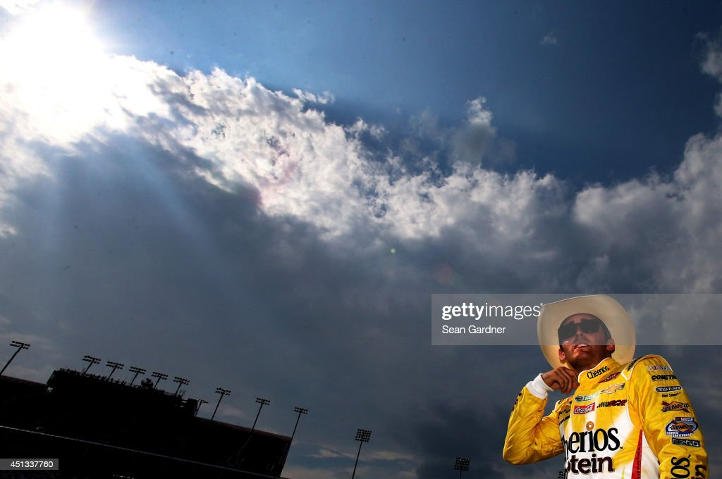 Austin Dillon, driver of the #3 Cheerios Protein Chevrolet, stands on the grid during qualifying for the NASCAR Sprint Cup Series Quaker State 400 presented by Advance Auto Parts at Kentucky Speedway on June 27, 2014 in Sparta, Kentucky.