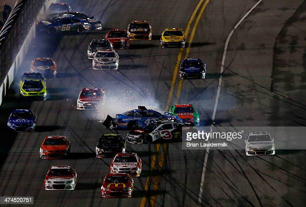 Austin Dillon driver of the DOW Chevrolet and Aric Almirola driver of the Smithfield Ford spin in a pack of cars during the NASCAR Sprint Cup Series...