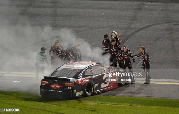 Austin Dillon driver of the DOW Chevrolet and crew celebrate winning the Monster Energy NASCAR Cup Series 60th Annual Daytona 500 at Daytona...