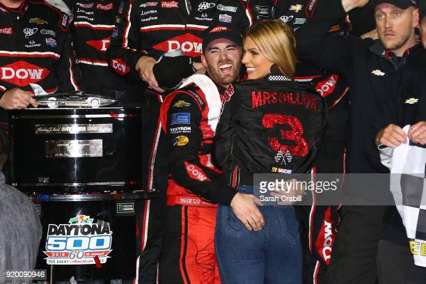 Austin Dillon driver of the DOW Chevrolet celebrates in Victory Lane with his fiancee Whitney Ward after winning the Monster Energy NASCAR Cup Series...
