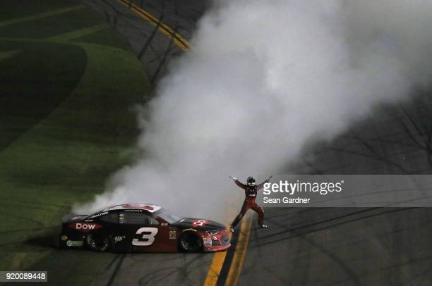 Austin Dillon driver of the DOW Chevrolet celebrates winning the Monster Energy NASCAR Cup Series 60th Annual Daytona 500 at Daytona International...