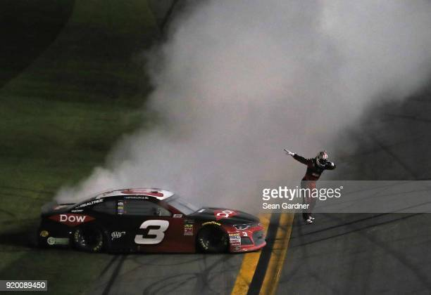 Austin Dillon, driver of the DOW Chevrolet, celebrates winning the Monster Energy NASCAR Cup Series 60th Annual Daytona 500 at Daytona International...
