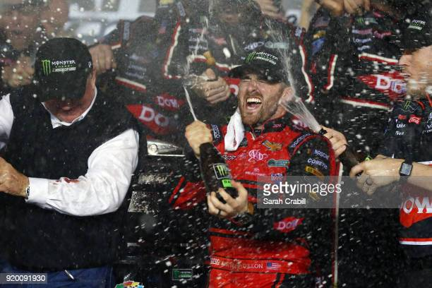 Austin Dillon, driver of the DOW Chevrolet, celebrates with champagne in Victory Lane after winning the Monster Energy NASCAR Cup Series 60th Annual...