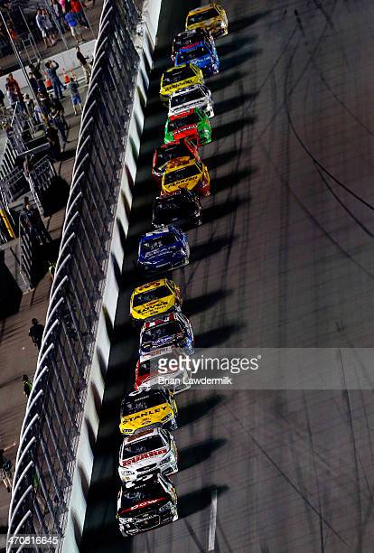 Austin Dillon driver of the DOW Chevrolet leads a pack of cars during the NASCAR Sprint Cup Series Budweiser Duel 1 at Daytona International Speedway...
