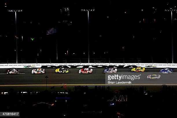 Austin Dillon driver of the DOW Chevrolet leads the field during the NASCAR Sprint Cup Series Budweiser Duel 1 at Daytona International Speedway on...