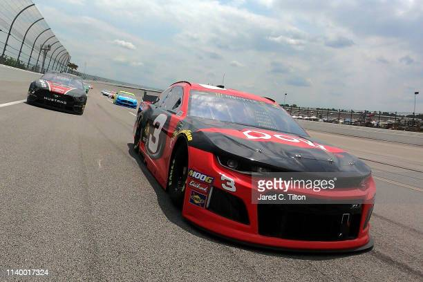 Austin Dillon, driver of the Dow Chevrolet, leads the field prior to the start of the Monster Energy NASCAR Cup Series GEICO 500 at Talladega...