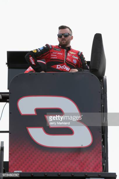 Austin Dillon driver of the Dow Chevrolet looks on from the top of his team hauler during practice for the Monster Energy NASCAR Cup Series Folds of...