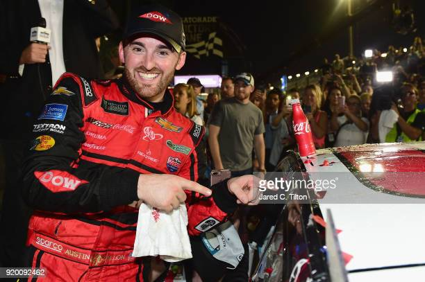 Austin Dillon driver of the DOW Chevrolet poses with the winner's decal in Victory Lane after winning the Monster Energy NASCAR Cup Series 60th...