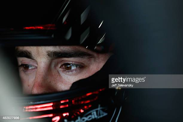 Austin Dillon, driver of the Dow Chevrolet, sits in his car in the garage area during practice for the NASCAR Sprint Cup Series Camping World RV...