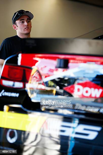 Austin Dillon driver of the DOW Chevrolet stands in the garage area during practice for the NASCAR Sprint Cup Series Sprint Unlimited at Daytona...