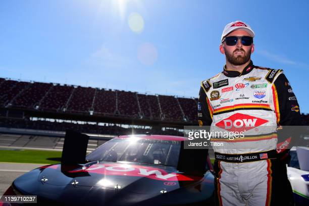 Austin Dillon driver of the Dow Chevrolet stands on the grid during qualifying for the Monster Energy NASCAR Cup Series GEICO 500 at Talladega...