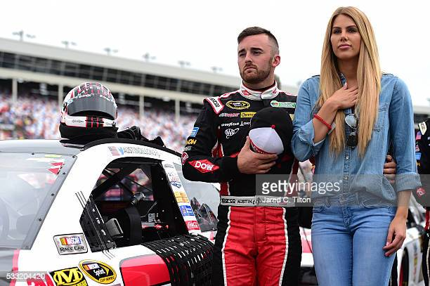 Austin Dillon driver of the DOW Chevrolet stands on the grid with his girlfriend Whitney Ward prior to the NASCAR Sprint Cup Series Sprint Showdown...
