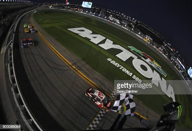 Austin Dillon driver of the DOW Chevrolet takes the checkered to win the Monster Energy NASCAR Cup Series 60th Annual Daytona 500 at Daytona...