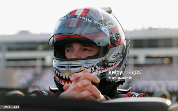 Austin Dillon driver of the Dow Chevrolet waits by his car during qualifying for the Monster Energy NASCAR Cup Series AllStar Race at Charlotte Motor...