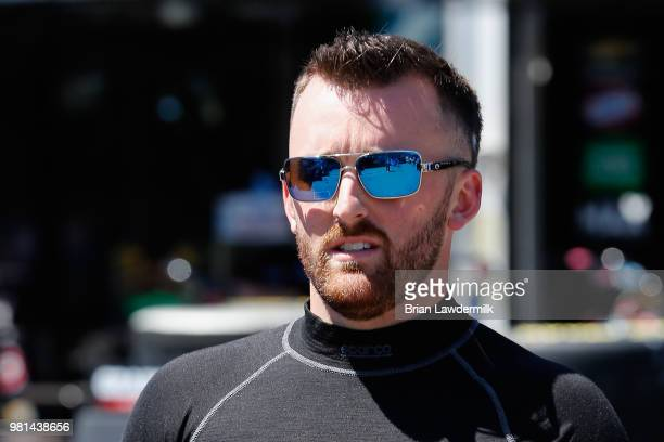 Austin Dillon driver of the Dow Chevrolet walks through the garage area during practice for the Monster Energy NASCAR Cup Series Toyota/Save Mart 350...