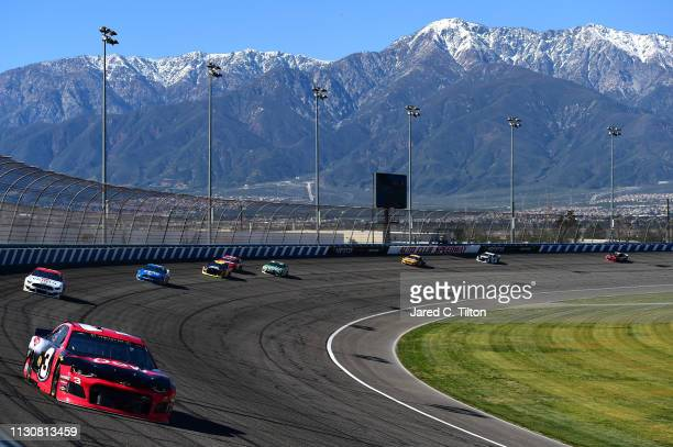 Austin Dillon driver of the Dow Coatings Chevrolet leads a pack of cars during qualifying for the Monster Energy NASCAR Cup Series Auto Club 400 at...