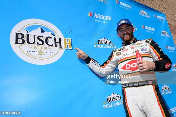 Austin Dillon driver of the Dow Coatings Chevrolet poses with the pole award after earning polo position during qualifying for the Monster Energy...