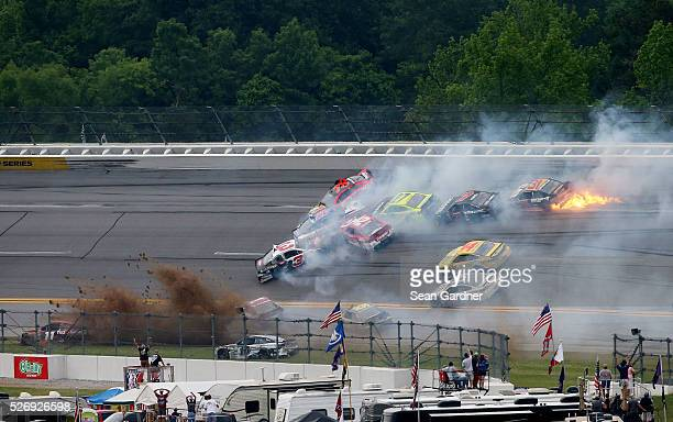 Austin Dillon driver of the Dow Energy Water/Intellifresh Chevrolet and others are involved in a large on track incident during the NASCAR Sprint Cup...