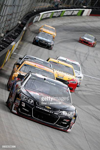 Austin Dillon driver of the DOW Great Stuff Chevrolet leads a pack of cars during the NASCAR Sprint Cup Series Bass Pro Shops NRA Night Race at...