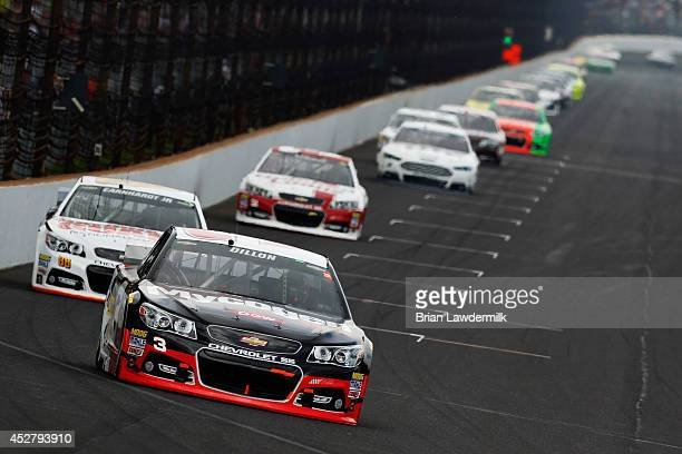 Austin Dillon driver of the Dow Mycogen Seeds Chevrolet leads a pack of cars during the NASCAR Sprint Cup Series Crown Royal Presents The John Wayne...