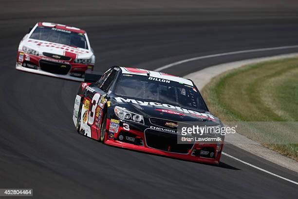 Austin Dillon driver of the Dow Mycogen Seeds Chevrolet leads Ryan Newman driver of the Quicken Loans Chevrolet during the NASCAR Sprint Cup Series...