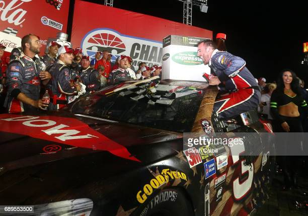 Austin Dillon driver of the DOW Salutes Veterans Chevrolet celebrates in Victory Lane during the Monster Energy NASCAR Cup Series CocaCola 600 at...