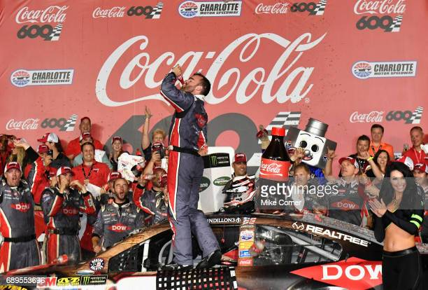 Austin Dillon driver of the DOW Salutes Veterans Chevrolet celebrates after winning the Monster Energy NASCAR Cup Series CocaCola 600 at Charlotte...
