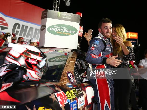 Austin Dillon driver of the DOW Salutes Veterans Chevrolet celebrates with his girlfriend Whitney Ward after winning the Monster Energy NASCAR Cup...