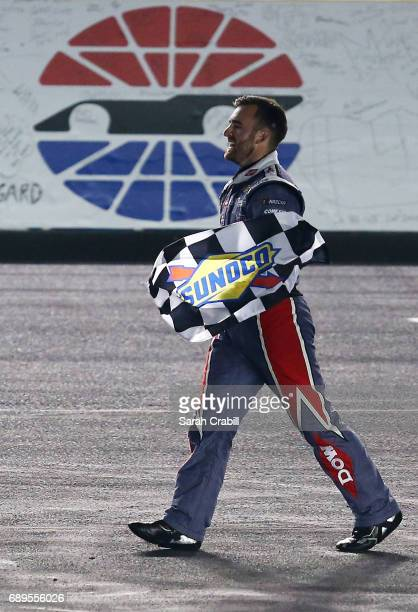 Austin Dillon driver of the DOW Salutes Veterans Chevrolet celebrates with the checkered flag during the Monster Energy NASCAR Cup Series CocaCola...