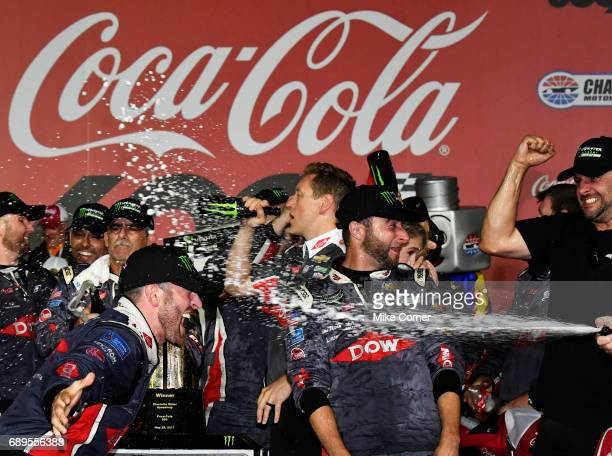 Austin Dillon driver of the DOW Salutes Veterans Chevrolet celebrates in victory lane after winning the Monster Energy NASCAR Cup Series CocaCola 600...
