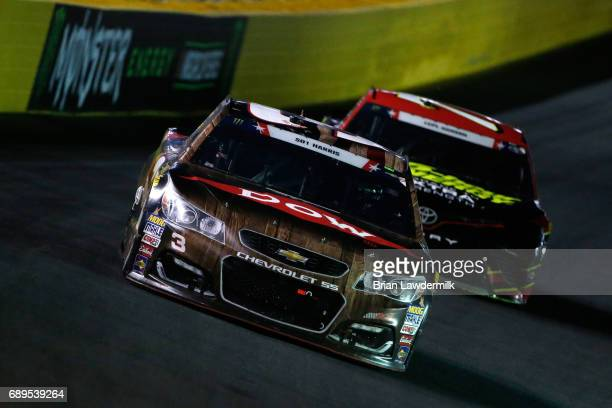 Austin Dillon driver of the DOW Salutes Veterans Chevrolet leads Erik Jones driver of the 5Hour ENERGY Extra Strength Toyota during the Monster...