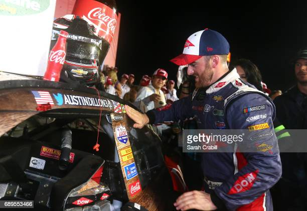Austin Dillon driver of the DOW Salutes Veterans Chevrolet poses for a photo with the winner's decal in Victory Lane during the Monster Energy NASCAR...