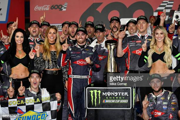 Austin Dillon driver of the DOW Salutes Veterans Chevrolet poses for a photo with the trophy after winning the Monster Energy NASCAR Cup Series...